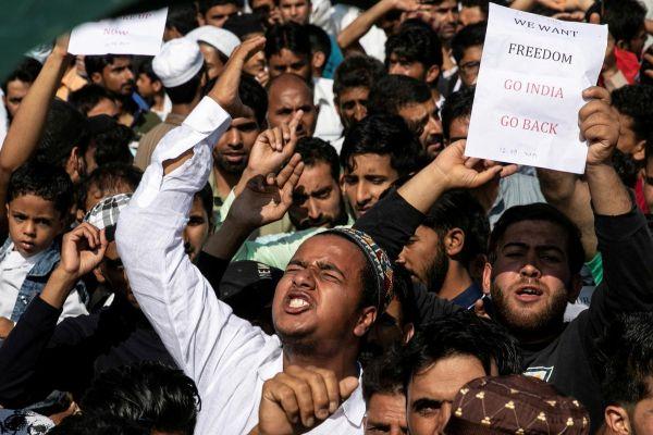 Besieged Kashmiri neighbourhood in test of wills with India's Modi