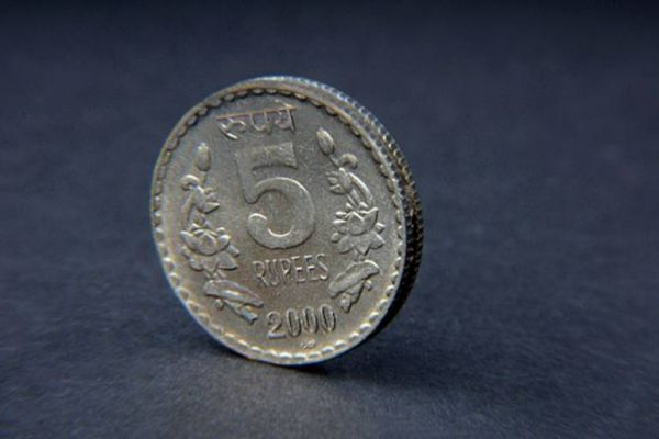 Rupee trades lower at 69 per dollar