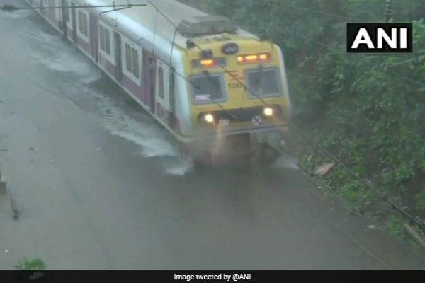 Trains Delayed As Heavy Overnight Rain In Mumbai Floods Tracks